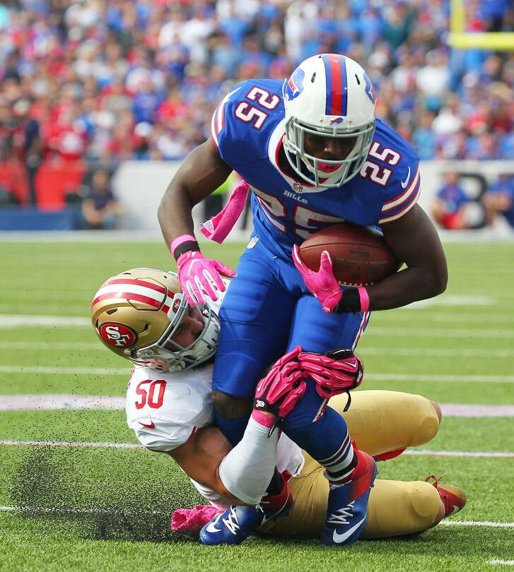 Buffalo Bills running back LeSean McCoy (25) is tackled by San Francisco 49ers inside linebacker Nick Bellore (50) during the first half of an NFL football game on Sunday, Oct. 16, 2016, in Orchard Park, N.Y. (AP Photo/Bill Wippert)
