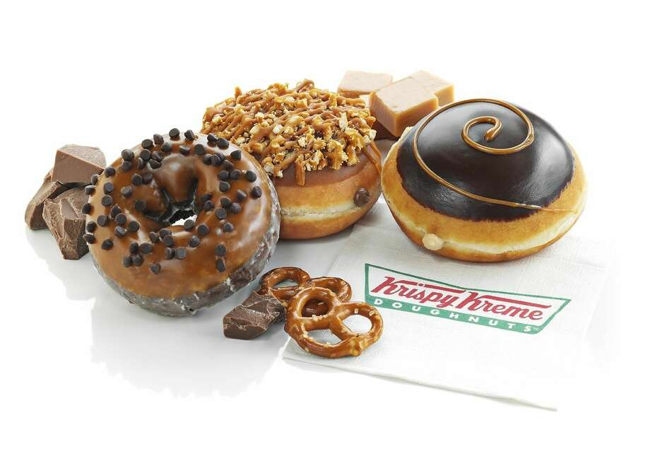 New doughnuts from Krispy Kreme offered during the summer are Caramel Chocolate Chip Cake, left, Caramel Chocolate Pretzel and Dark Chocolate Caramel Kreme. (Courtesy of Krispy Kreme)