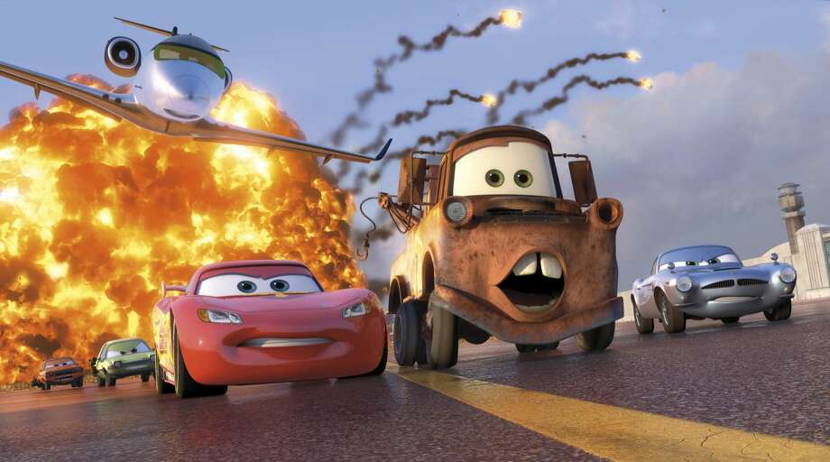 "Animated characters Lightning McQueen, voiced by Owen Wilson, foreground left, Mater, voiced by Larry the Cable Guy, center, and Finn McMissile, voiced by Michael Caine, right, are shown in a scene from ""Cars 2."""