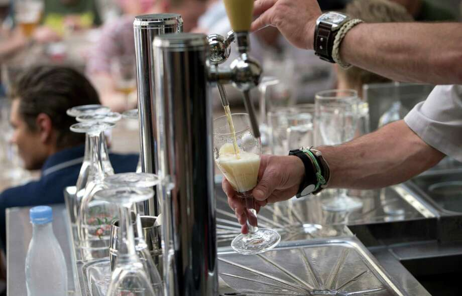 LIST: Texas craft beersA Dutch beer company is willing to pay someone $14,000 to sit around and drink beer for four hours.Click through to see a list of the best craft beers in Texas. Photo: Virginia Mayo, STF / Copyright 2016 The Associated Press. All rights reserved. This material may not be published, broadcast, rewritten or redistribu