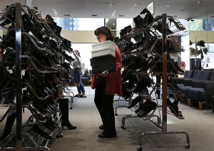 Sales Associate Tina Kastoras looks for a shoe while helping a customer inside Arthur Beren Shoes in Union Square Oct. 21, 2016 in San Francisco, Calif. The store, which opened in 1988 is facing closure due to lost revenue and rising rents.