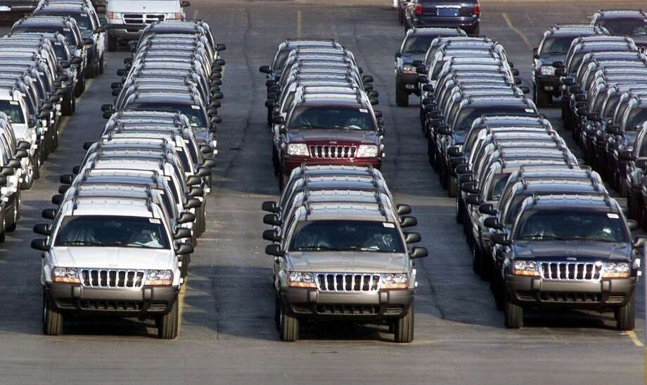 In this file photo taken Fed. 2, 2001, rows of 2001 Jeep Grand Cherokees are lined up outside the Jefferson North Assembly Plant in Detroit. Chrysler is refusing a request by U.S. safety regulators to recall about 2.7 million vehicles to fix fuel tanks that could leak and cause fires in rear-end collisions.The company says it's been asked by the government to recall Jeep Grand Cherokees from 1993 through 2004 and Jeep Libertys from 2002 through 2007. But Chrysler says in a statement that the SUVs are safe and not defective. (AP Photo/Carlos Osorio, File)