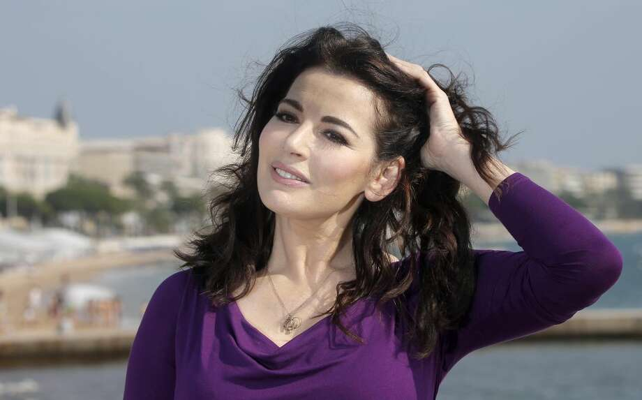In this Tuesday, Oct. 9, 2012 file photo, English food writer, journalist and broadcaster, Nigella Lawson poses during the 28th MIPCOM (International Film and Programme Market for Tv, Video,Cable and Satellite) in Cannes, southeastern France. British police say they are investigating after a newspaper published photos of Nigella Lawson's husband Charles Saatchi with his hands around the celebrity chef's throat. The Sunday People newspaper ran pictures of what it said was the couple's violent argument at a London restaurant on June 9, 2013. (AP Photo/Lionel Cironneau, File)