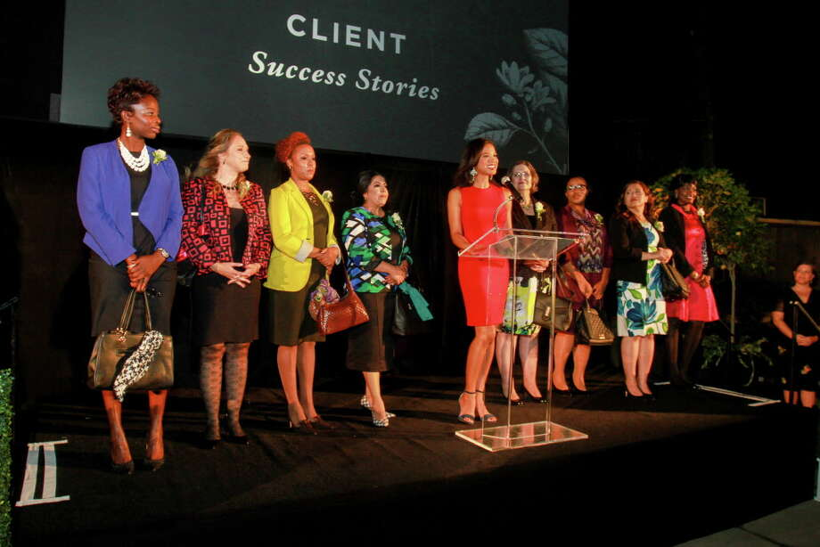 Mia Gradney, center, with Dress for Success Houston success stories, addresses the benefit audience. Photo: Gary Fountain, For The Chronicle / Copyright 2016 Gary Fountain