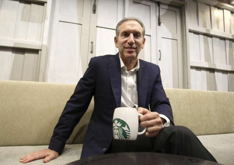 In this Monday, May 13, 2013, file photo, starbucks CEO Howard Schultz poses for the photographer during a press conference in Bangkok, Thailand. Starbucks said Friday, June 21, 2013, it's hiking prices on average by 1 percent nationally starting on Tuesday, June 25, 2013. But the companysays the price for many drinks, such as medium and large brewed coffees and Frappuccinos, won't change in most its 11,000 U.S. cafes. (AP Photo/Sakchai Lalit, File)