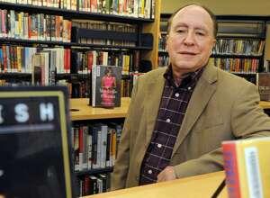 John Soltis stands in the Black Rock Branch Library in Bridgeport.  Soltis has been named interim director of Bridgeport libraries.
