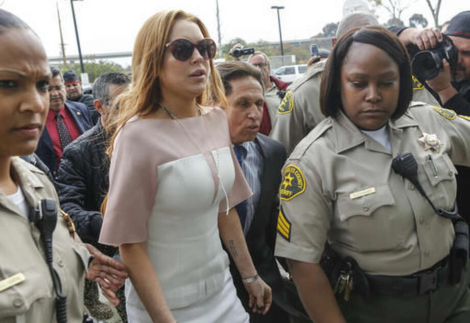 FILE - In this file photo dated Monday, March 18, 2013, actress Lindsay Lohan arrives at the Los Angeles Superior court, charged with three misdemeanor counts stemming from a car crash on Pacific Coast Highway. Turkey's state-run news agency Anadolu reported Monday Sept. 26, 2016, details of Hollywood star Lindsay Lohan visiting Syrian refugees at a hospital in Istanbul which employs only Syrian doctors and treats refugees. (AP Photo/Damian Dovarganes, FILE)