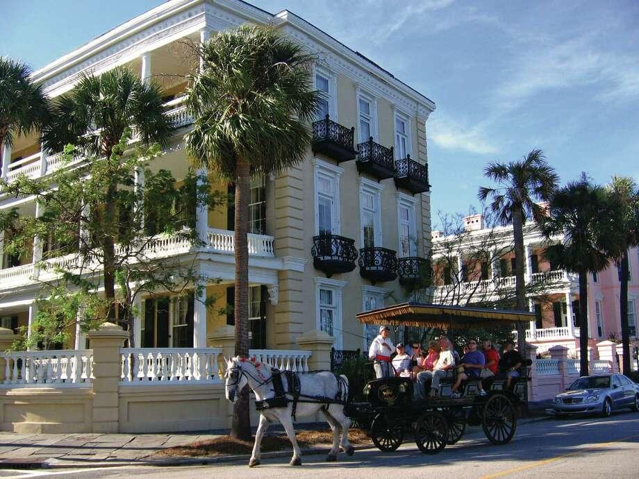 Opulent homes along Charleston's battery surround White Point Garden. / ONLINE_YES