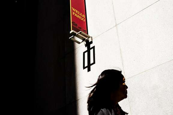 A former sales representatives at Wells Fargo outside the Wells Fargo headquarters in San Francisco, Sept. 16, 2016. The scandal at Wells Fargo over the creation of unauthorized accounts shook its customers� faith, but it took an even sharper toll on workers, a number of whom say they faced a stark choice: Create new accounts by any means possible, or risk being fired for falling short of their sales goals. (Max Whittaker/The New York Times)