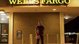 Kevin Pham, a former Wells Fargo employee now running a campaign urging customers to close their accounts, stands outside a branch in Daly City, Calif., Oct. 18, 2016. Wells Fargo would like to close the chapter on its sham account scandal, but lawmakers and regulators will not let it go that quickly, and emerging evidence that some victims were among the bankÕs most vulnerable customers has given them fresh ammunition.