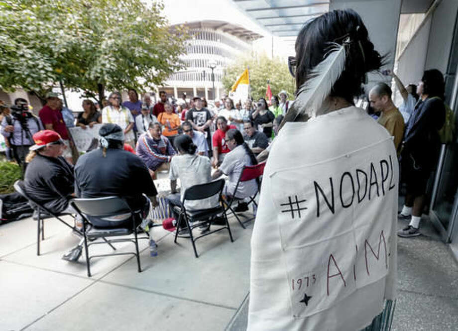 Members of the Ponca, Santee, Winnebago and Omaha Tribes in Nebraska and Iowa along with others participate in a rally on Thursday, Sept. 8, 2016, in front of the Army Corps of Engineers offices in Omaha, Neb., to protest against the Dakota Access Pipeline in the Dakotas and Iowa. A judge is expected to rule Friday on whether to block construction of the pipeline that is supposed to pass close to the tribal reservation near the North Dakota-South Dakota border. (AP Photo/Nati Harnik)
