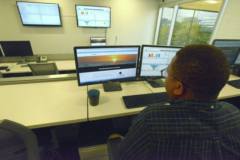 Jereel Udom, a security analyst with Cybershark of BlackStratus logs into a secure portal in the Security Operations Center (SOC) at their Stamford based offices on Thursday, Oct. 20, 2016. Photo: Matthew Brown / Hearst Connecticut Media / Stamford Advocate