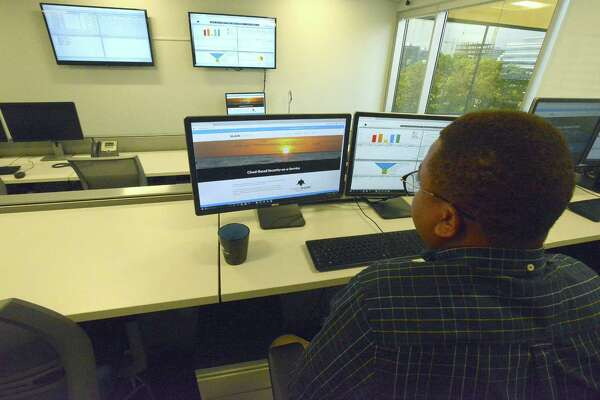 Jereel Udom, a security analyst with Cybershark of BlackStratus logs into a secure portal in the Security Operations Center (SOC) at their Stamford based offices on Thursday, Oct. 20, 2016.