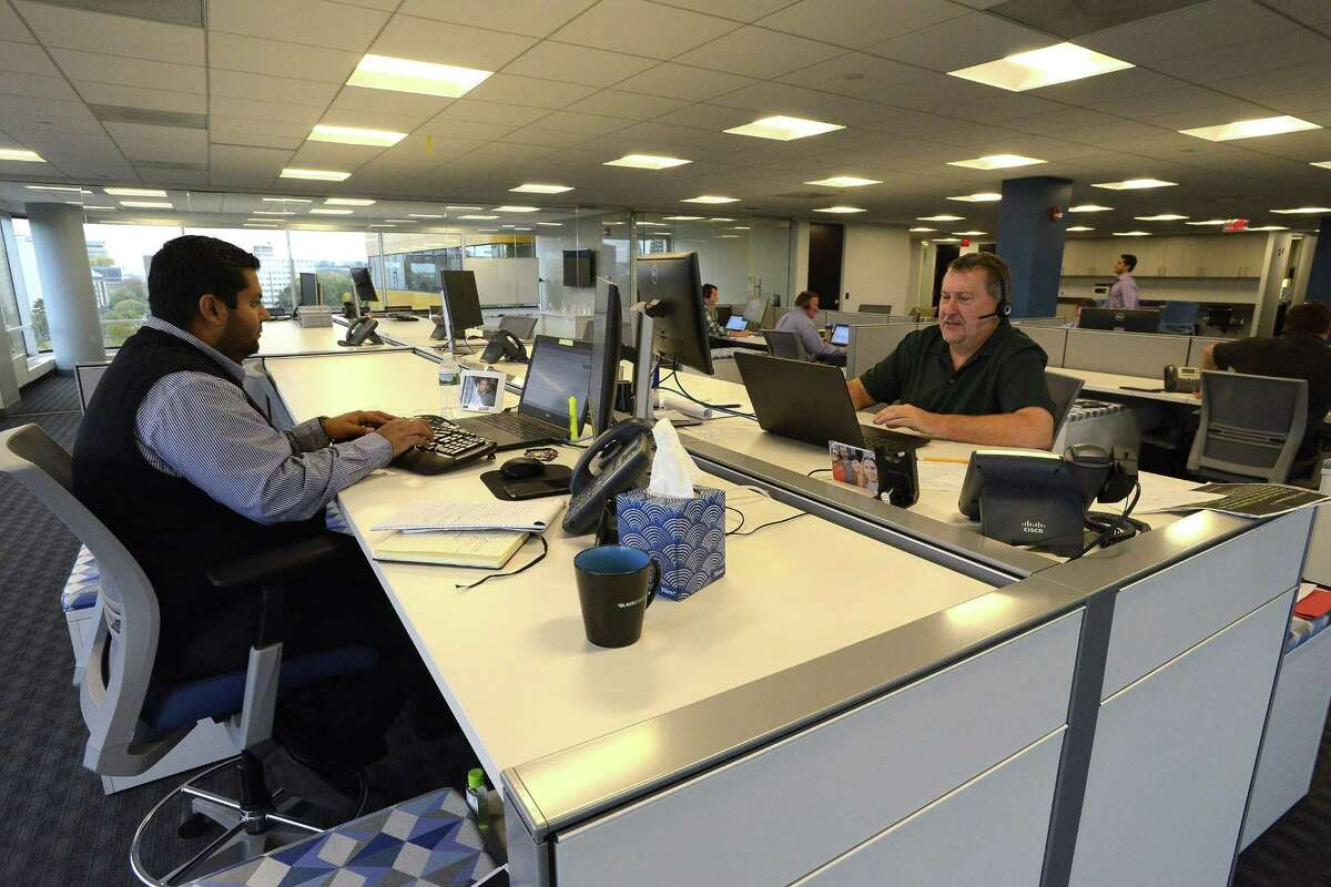 BlackStratus employees work with Cybershark clients at their Stamford based offices on Thursday, Oct. 20, 2016.