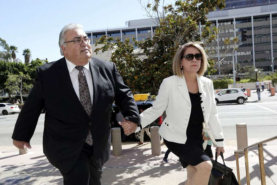 Former state Sen. Ron Calderon and his wife Ana arrive for his sentencing on bribery charges at federal court in Los Angeles Friday, Oct. 21, 2016. Charged in a corruption scandal that could have sent him to prison for three lifetimes, Calderon dropped his entrapment defense, pleaded guilty and admitted taking bribes in exchange for his influence in Sacramento. (AP Photo/Nick Ut) Photo: Nick Ut, Associated Press