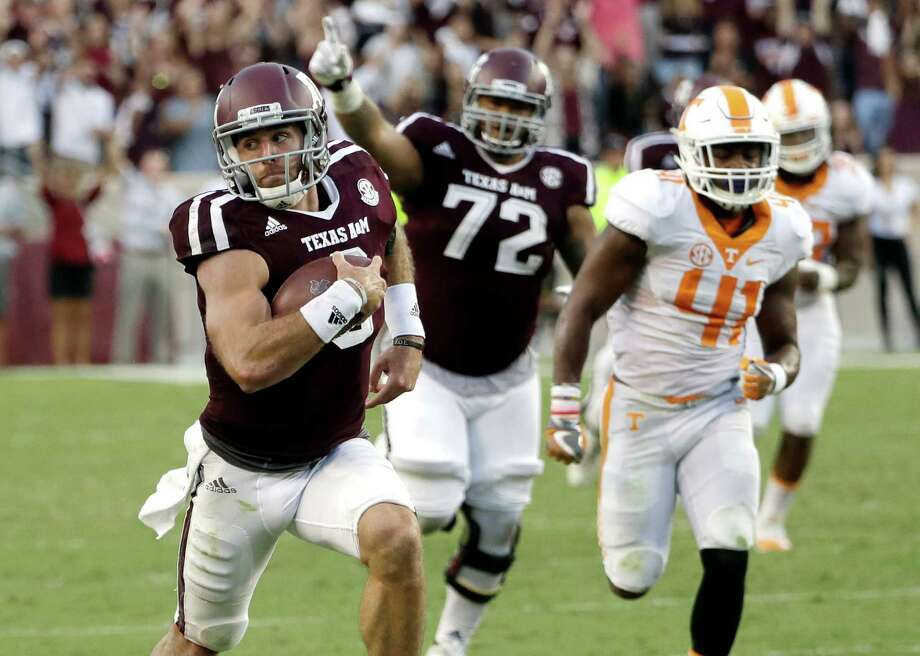 FILE - In this Saturday, Oct. 8, 2016, file photo, Texas A&M quarterback Trevor Knight (8) rushes for a touchdown against Tennessee during the second half of an NCAA college football game in College Station, Texas. Knight could get the beat-Bama bump  in the Heisman trace with a big game in Tuscaloosa.  (AP Photo/David J. Phillip, File) Photo: David J. Phillip, STF / Copyright 2016 The Associated Press. All rights reserved.