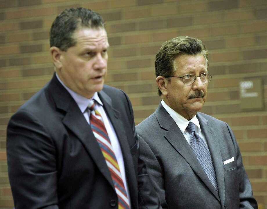 Former Danbury Mayor Eugene Eriquez, right, represented by Attorney Michael McGetrick, appears in state Superior Court in Danbury Tuesday, June 28, 2016, on charges of domestic abuse. Photo: Carol Kaliff / Carol Kaliff / The News-Times