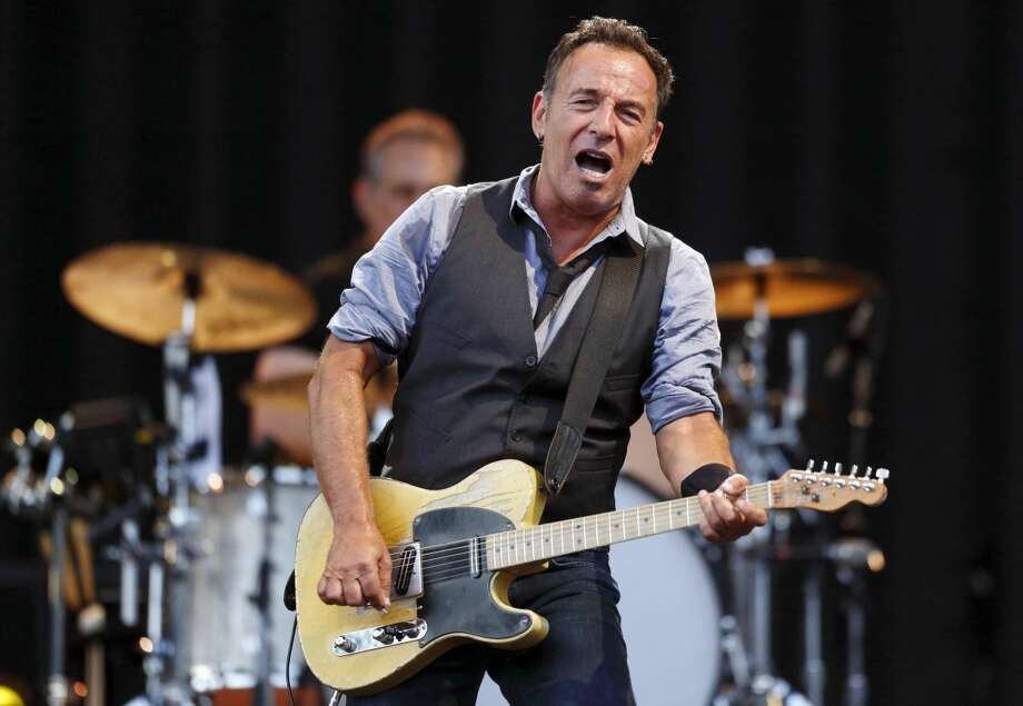 This Aug. 14, 2012 file photo shows Bruce Springsteen performing at Fenway Park in Boston. NBC is holding a benefit concert for victims of Hurricane Sandy featuring some artists native to the areas hardest hit. Bruce Springsteen and Jon Bon Jovi of New Jersey and Billy Joel of Long Island are scheduled to appear at the concert Friday, Nov. 2. (AP Photo/Michael Dwyer, file)