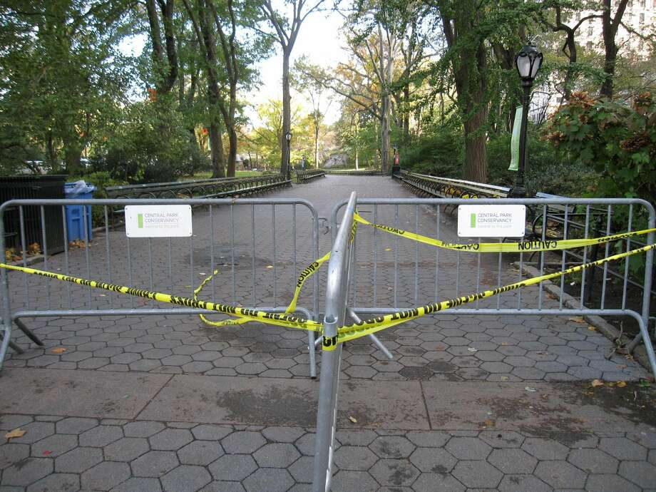 The entrance to Central Park is blocked off at 59th Street in New York on Wednesday, Oct. 31, 2012. All city parks are closed indefinitely pending damage assessment from superstorm Sandy. The Central Park Conservancy said at least 250 mature trees were felled by the storm, with benches and playgrounds damaged as well. (AP Photo/Beth J. Harpaz)