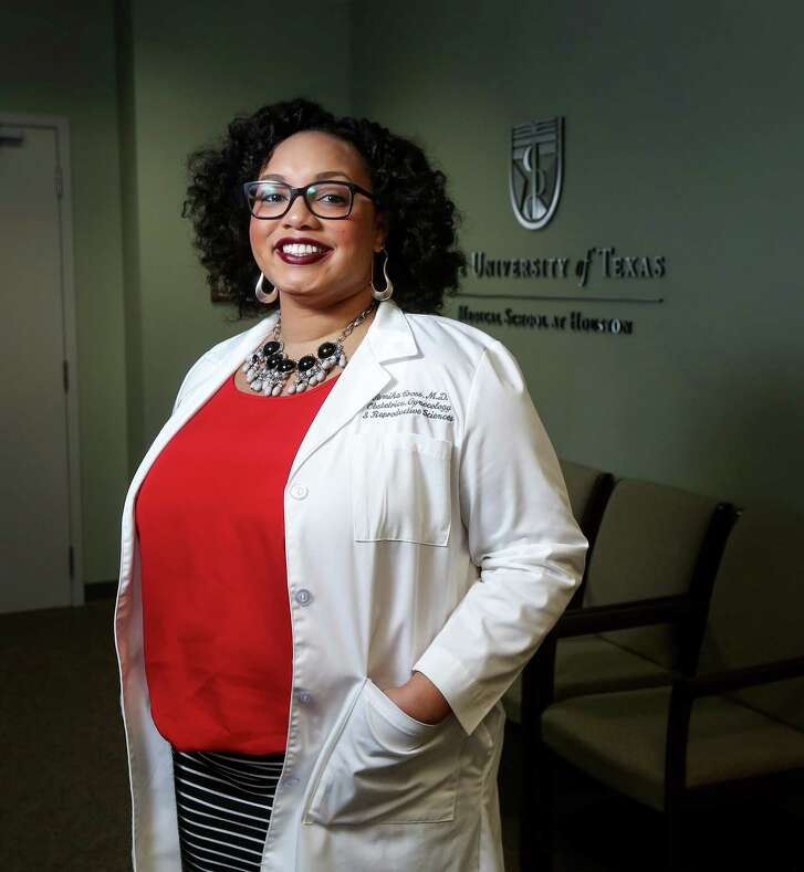 Dr. Tamika Cross poses for a portrait Thursday, Oct. 20, 2016, in Houston. Cross posted to Facebook about an experience when a flight attendant did not believe she was a medical doctor.