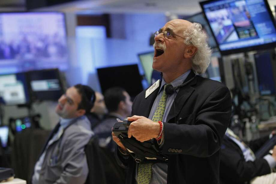 Trader Peter Tuchman reacts as he looks at the numbers during the closing bell on the floor of the New York Stock Exchange, Friday, Oct. 19, 2012. Poor corporate earnings reports pounded the stock market Friday in a sour end to an otherwise strong week of trading. The Dow Jones industrial average fell more than 200 points for its worst day in four months. (AP Photo/Mary Altaffer)