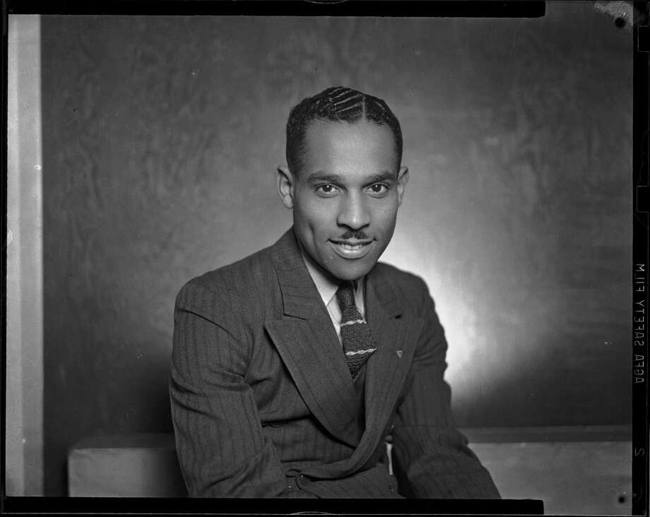 "In this 1940 photo taken by Pittsburgh photographer Charles ""Teenie"" Harris, and provided by the Carnegie Museum of Art, Harris poses for a self-portrait in his Hill District photo studio in Pittsburgh. The ""Teenie Harris, Photographer: An American Story"" exhibit runs through April 7, at the Carnegie Museum of Art in Pittsburgh. (AP Photo/Charles Teenie Harris via Carnegie Museum of Art)"