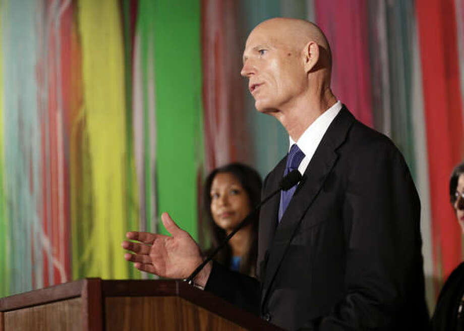 Florida Gov. Rick Scott speaks during a news conference at Wynwood Walls, Monday, Sept. 19, 2016, in the Wynwood neighborhood of Miami. The governor said the arts district is no longer considered a zone of active Zika transmission. It has been 45 days since the last Zika detection. (AP Photo/Lynne Sladky)