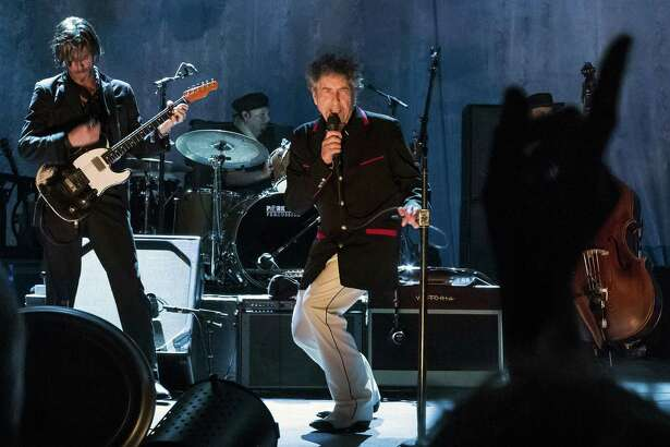 "Bob Dylan performs in Port Chester, N.Y., in 2012. Dylan was awarded the Nobel Prize in literature for creating ""new poetic expressions within the great American song tradition,"" according to the Swedish Academy. A reader criticizes the choice."
