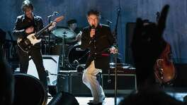 """Bob Dylan performs in Port Chester, N.Y., in 2012. Dylan was awarded the Nobel Prize in literature for creating """"new poetic expressions within the great American song tradition,"""" according to the Swedish Academy. A reader criticizes the choice."""