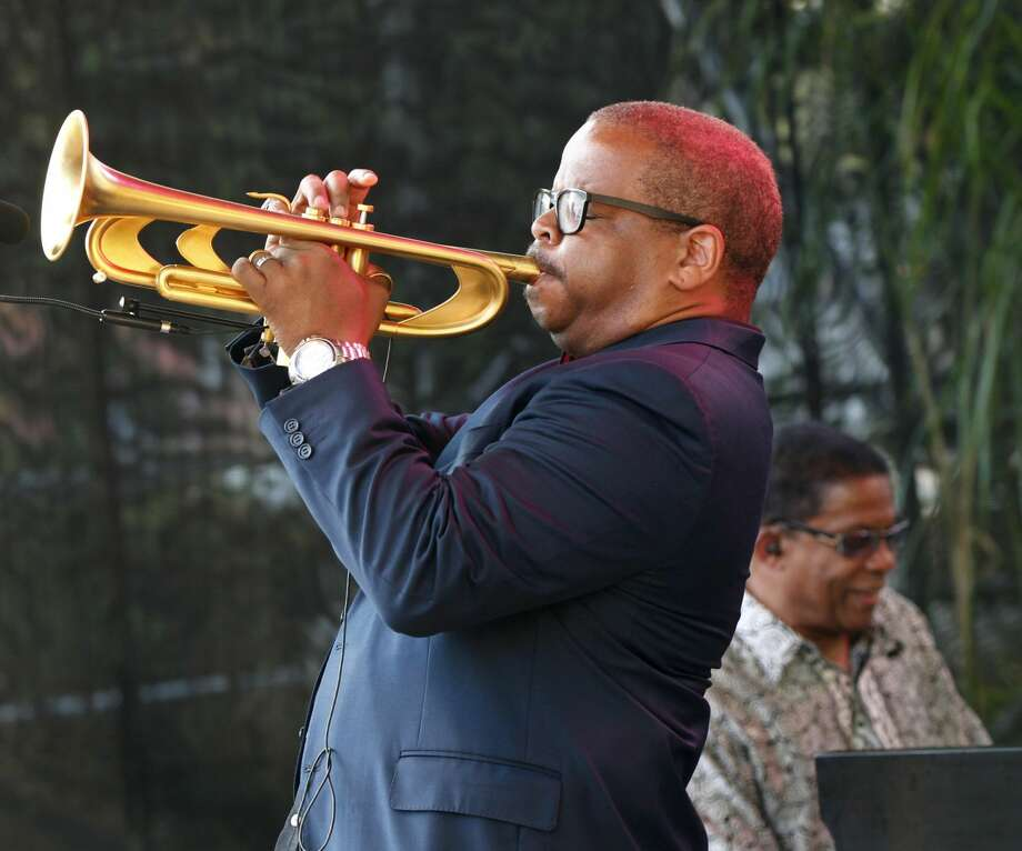 Terence Blanchard, foreground, and Herbie Hancock perform at a sunrise concert marking International Jazz Day in New Orleans on Monday. The performance, at Congo Square near the French Quarter, is one of two in the United States that day; the other is in the evening in New York. Thousands of people across the globe are expected to participate in International Jazz Day, including events in Belgium, France, Brazil, Algeria and Russia. (AP Photo/Gerald Herbert)