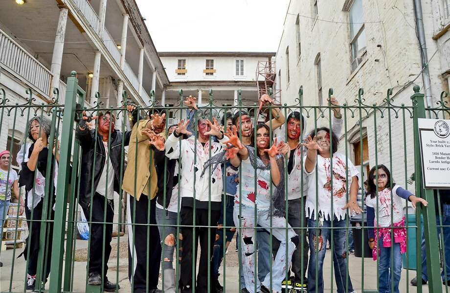 Students of the Laredo Job Corps and other zombie enthusiasts reach out for the cameras just outside the Bender Hotel in Oct. 2012. (Photo by Danny Zaragoza, File/Laredo Morning Times) Photo: Danny Zaragoza/Laredo Morning Times