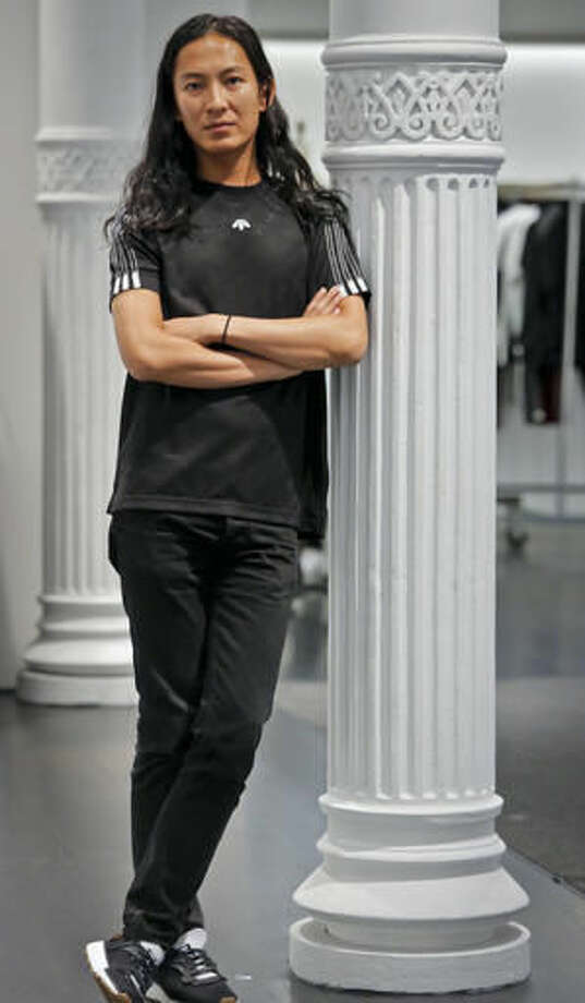 "Fashion designer Alexander Wang pose in his studio Tuesday, Sept. 6, 2016, in New York. Wang will unveil his latest collection during Fashion Week, including his collaboration with Adidas-- ""adidas Originals by Alexander Wang,"" (AP Photo/Bebeto Matthews)"