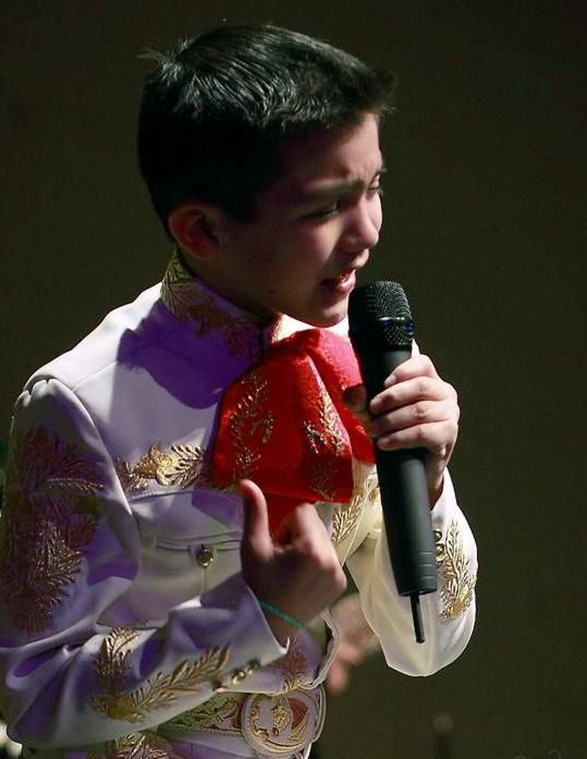 In this undated publicity photo released courtesy of Mariachi Spectacular de Albuquerque, 11-year-old San Antonio-born Sebastien de la Cruz is shown performing at one of his many concerts.