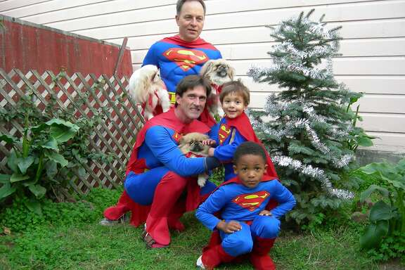 The Fisher-Paulsons dress as super heroes for Halloween.