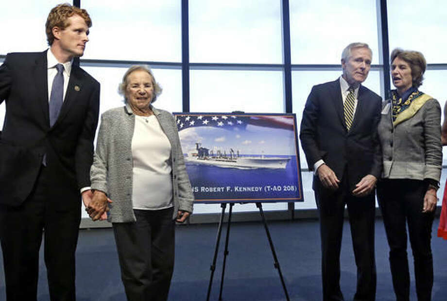 Ethel Kennedy, widow of Sen. Robert F. Kennedy, holds hands with grandson Joseph P. Kennedy III, left, while Navy Secretary Ray Mabus chats with her daughter Kathleen Kennedy Townsend, as they pose near a rendering of the Robert F. Kennedy Navy Ship named at the John F. Kennedy Presidential Library, Tuesday, Sept. 20, 2016, in Boston. The new ship's job will be to restock and refuel other ships already at sea. Ships in this class are being named in honor of civil and human rights heroes. (AP Photo/Elise Amendola)