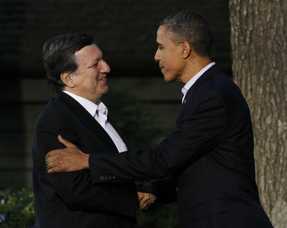 FILE - This is a Friday, May 18, 2012 file photo of President Barack Obama, right, greets President of the European Commission Jose Manuel Barroso on Barroso's arrival for the G8 Summit at Camp David, Md. The backlash in Europe over U.S. spying is threatening an agreement that generates tens of billions of dollars in trans-Atlantic business every year _ and negotiations on another pact worth many times more. (AP Photo/Charles Dharapak, File)