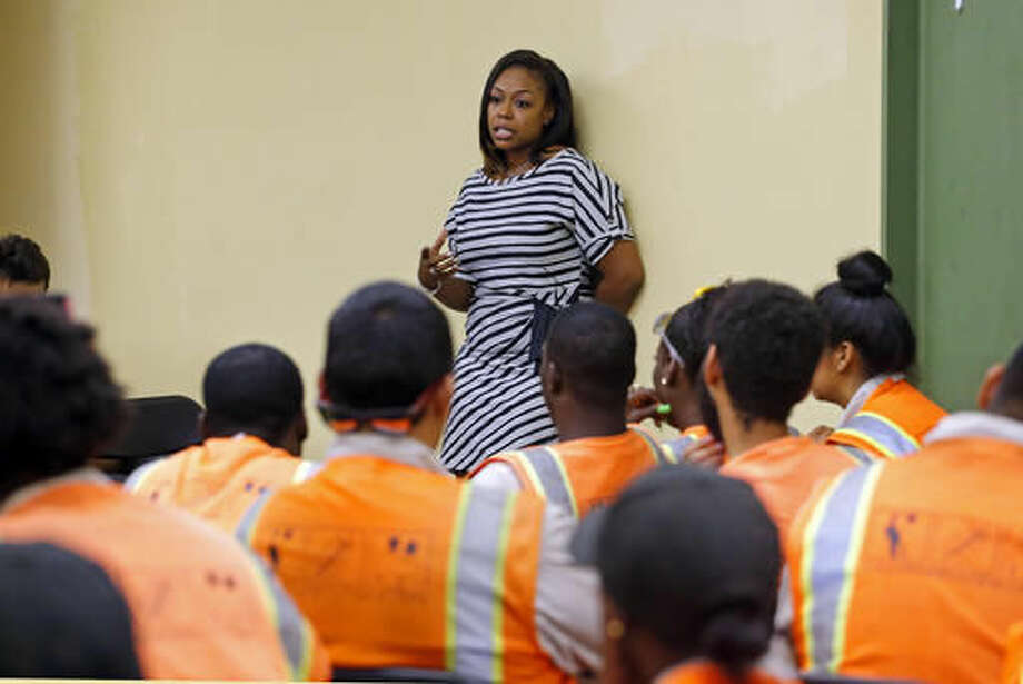 Rodney King's daughter Lora King, 32, speaks to a group of young people who have had their own run-ins with police at a meeting of the Los Angeles Conservation Corps, which provides at-risk youth with job training, education and work, in downtown Los Angeles Thursday, Sept. 15, 2016. She was just 7 when her father was beaten by the Los Angeles Police Department. Her message: It's more important to build bridges with officers than to stand against the, and that a whole police department can't be judged by the actions of a few. (AP Photo/Reed Saxon)