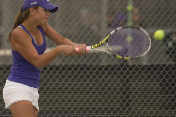 Midland High's Allison Stewart returns a shot Friday 04-08-16 during the championship doubles match with Kate Daugherty at the District 3-6A tournament at Bush Tennis Center. Tim Fischer\Reporter-Telegram