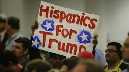 A Hispanic supporter holds up  a sign for Republican presidential candidate Donald Trump during a rally at the Anaheim Convention Center, Wednesday, May 25, 2016, in Anaheim, Calif. (AP Photo/Jae C. Hong)