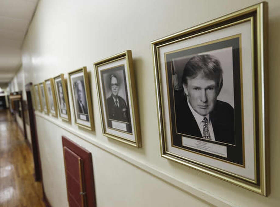 In this Thursday, Sept. 8, 2016 photo, a portrait of Donald Trump hangs on the wall at the New York Military Academy, in Cornwall-on-Hudson, N.Y. While Republican presidential nominee, Trump, talks tough about dealing with China, his old military prep school is building bridges to that country. The New York Military Academy began classes this fall with new Chinese backing and a former New York City high school principal originally from China in charge. (AP Photo/Mike Groll)
