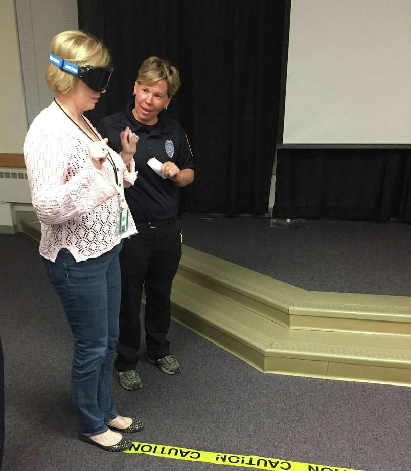 During a drunk goggle simulation, Eileen Francis prepares to take a field sobriety test while wearing goggles that mimic a .06 to .08 blood alcohol content, just below the legal limit. The simulation was part of a DUI presentation during the second Westport Citizens' Police Academy class on Sept. 15, 2016 in Westport, Conn. Photo: Laura Weiss / Hearst Connecticut Media / Westport News