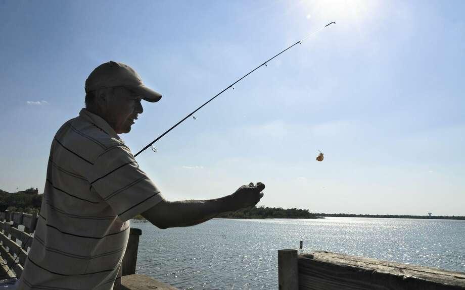 Manuel Santillan fishes at Lake Casa Blanca on Oct. 21, 2012. (Ulysses S. Romero, File/Laredo Morning Times)