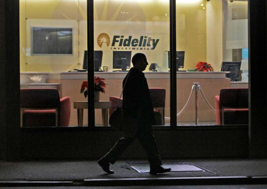 In this Thursday, Dec. 4, 2008 file photo, a man walks past a Fidelity Investments office in the Financial District of downtown Boston. On Wednesday, Oct. 9, 2013, the nation's largest manager of money market mutual funds said that it no longer holds any U.S. government debt that comes due around the time the nation could hit its borrowing limit. Money market portfolio managers at Fidelity Investments have been selling off their government debt holdings over the last couple of weeks, said Nancy Prior, president of Fidelity's Money Market Group. While Fidelity expects the debt ceiling issue to be resolved, the Boston-based asset manager said it is taking steps to protect investors. (AP Photo/Charles Krupa)