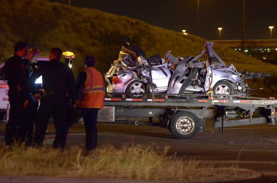 A truck tows Marisol J. Estrada's vehicle after it hit a stationary tractor-trailer near Loop 20 and Interstate 35 on Tuesday evening. Estrada was airlifted with severe head trauma. (Danny Zaragoza/Laredo Morning Times)