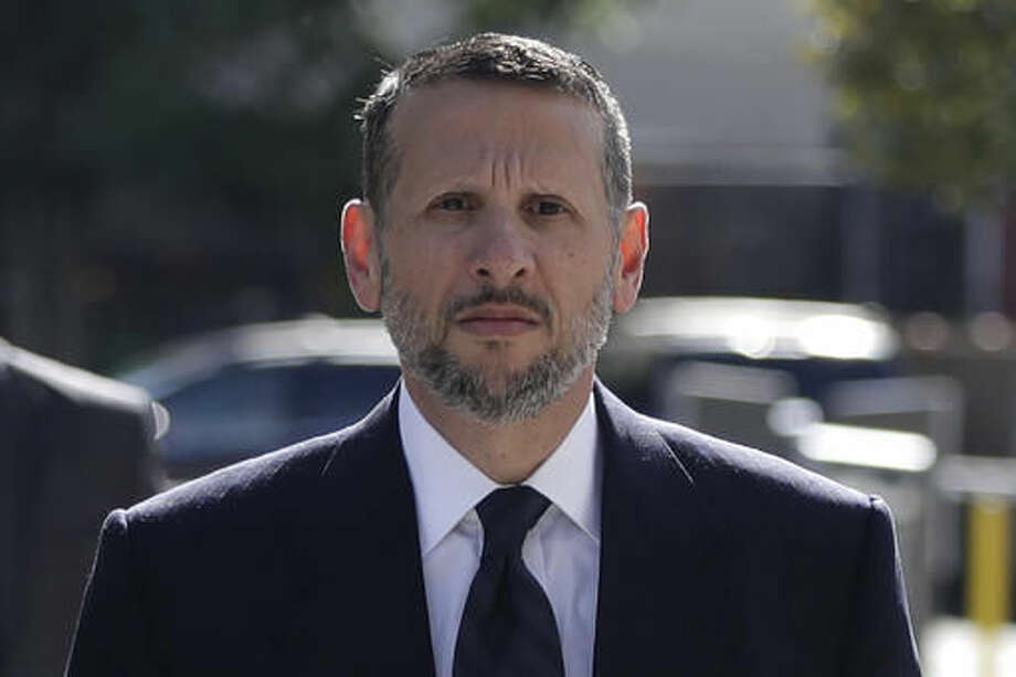 David Wildstein arrives at Martin Luther King Jr. Federal Courthouse for a hearing, Friday, Sept. 23, 2016, in Newark, N.J. Wildstein, pleaded guilty last year to orchestrating traffic jams in 2013 to punish a Democratic mayor who didn't endorse Gov. Chris Christie. Three years after gridlock paralyzed a New Jersey town next to the George Washington Bridge for days, two former allies of Christie, Bill Baroni and Bridget Kelly, are being tried. (AP Photo/Julio Cortez)
