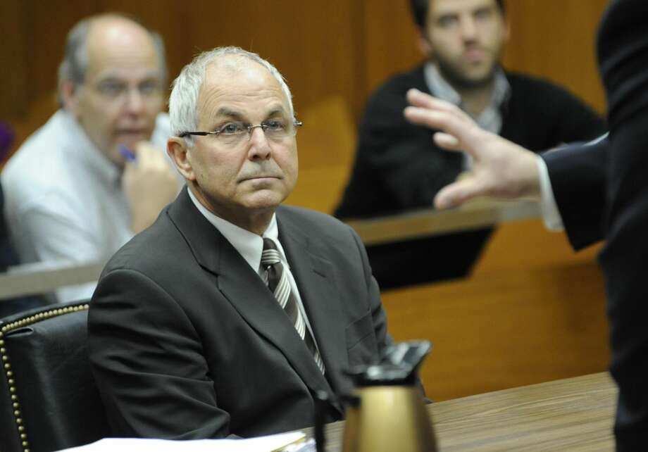In this April 3, 2009 file photo, Peter Madoff, brother of Bernard Madoff, attends his court hearing before judge Stephen Bucaria at Mineola State Supreme Court, in Mineola, N.Y. (AP Photo/Louis Lanzano, Pool, File)
