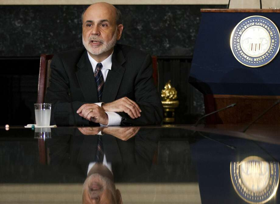 In this Tuesday, Aug. 7, 2012, file photo, Federal Reserve Chairman Ben Bernanke speaks to educators in the board room of the Federal Reserve in Washington, during a town hall meeting. Investors are hoping Chairman Ben Bernanke will at least hint Friday, Aug. 31, 2012, that the Federal Reserve is ready to launch another round of bond purchases to try to lower long-term U.S. interest rates and spur more borrowing and spending. (AP Photo/Manuel Balce Ceneta, File)