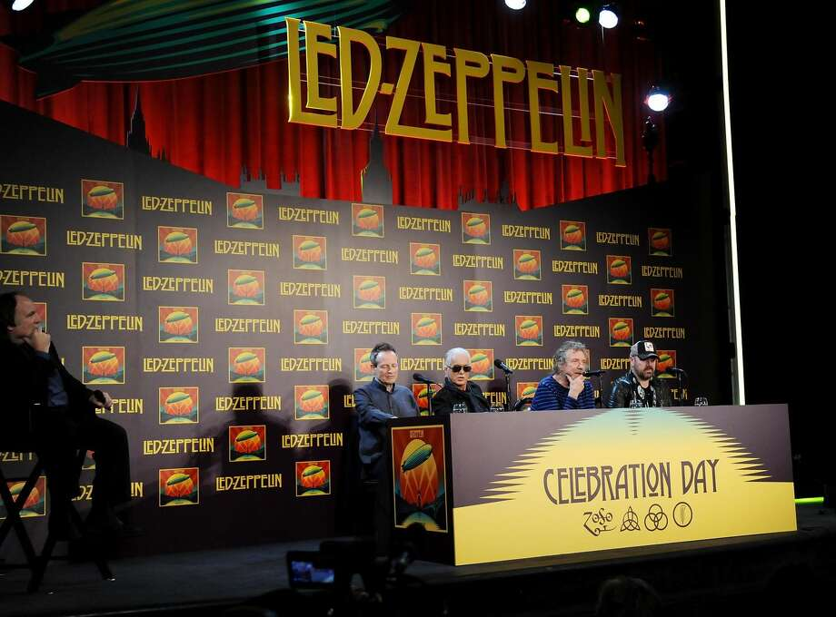 "Led Zeppelin, from left, bassist/keyboardist John Paul Jones, guitarist Jimmy Page, singer Robert Plant, and drummer Jason Bonham participate in a press conference ahead of the worldwide theatrical release of ""Celebration Day,"" a concert film of their 2007 London O2 arena reunion show, at the Museum of Modern Art on Tuesday, Oct. 9, 2012 in New York. (Photo by Evan Agostini/Invision/AP)"