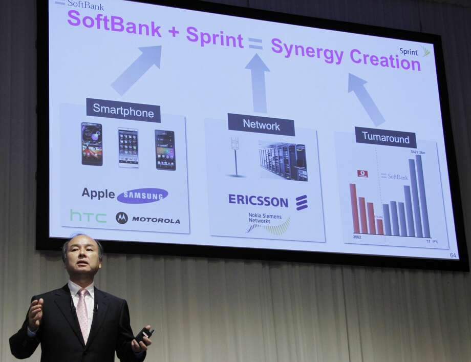 Softbank Corp. President Masayoshi Son speaks during a joint press conference with Sprint Nextel Corp. Chief Executive Dan Hesse in Tokyo Monday, Oct. 15, 2012. Tokyo-based mobile carrier Softbank has reached a deal with Sprint to acquire 70 percent of the U.S. wireless company for $20.1 billion in the largest ever foreign acquisition by a Japanese company. (AP Photo/Koji Sasahara)