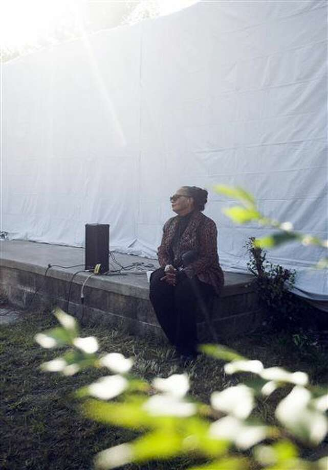 Rhea McCauley, family member of Rosa Parks, listens to a speaker at an event outside of Rosa Parks' old home in Detroit on Sunday, Sept. 25, 2016. A former Detroit home of civil rights icon Rosa Parks is set to be torn down and refashioned for a new purpose. (Nate Smallwood/Detroit Free Press via AP)